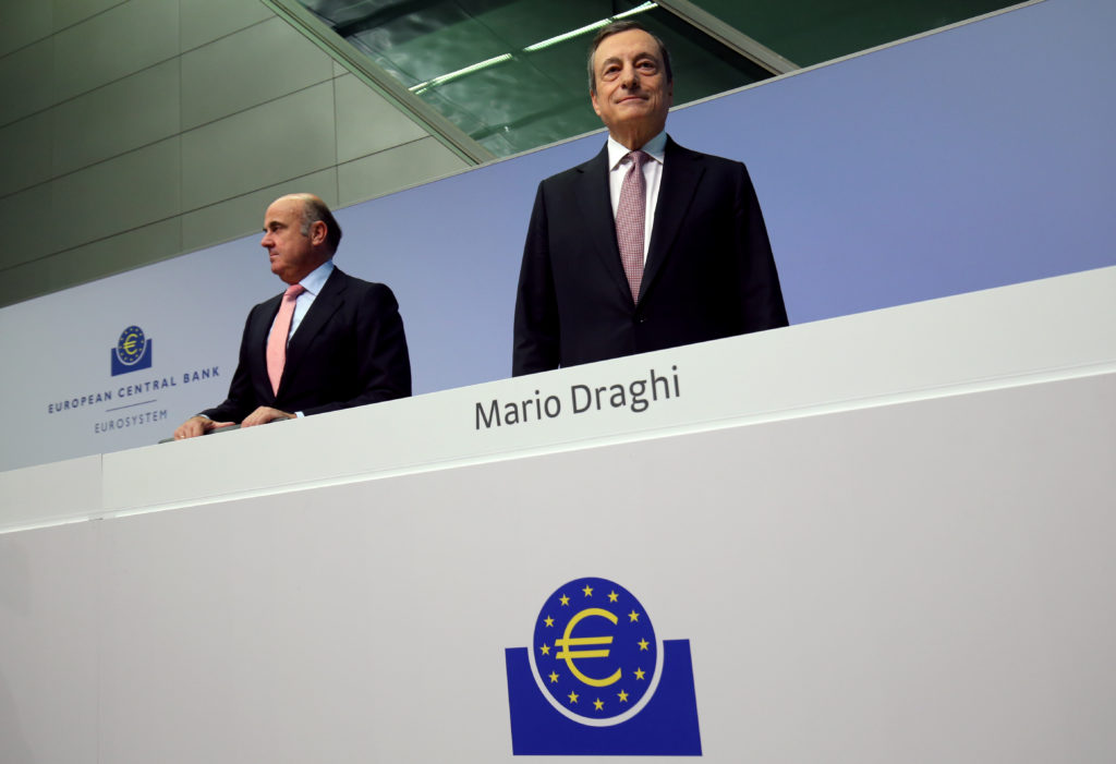 European Central Bank (ECB) President Mario Draghi and Vice-President Luis de Guindos arrive for a news conference at the ...