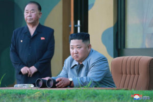 FILE PHOTO: North Korean leader Kim Jong Un watches the test-fire of two short-range ballistic missiles on Thursday, in this undated picture released by North Korea's Central News Agency (KCNA) on July 26, 2019. Photo by KCNA/via Reuters