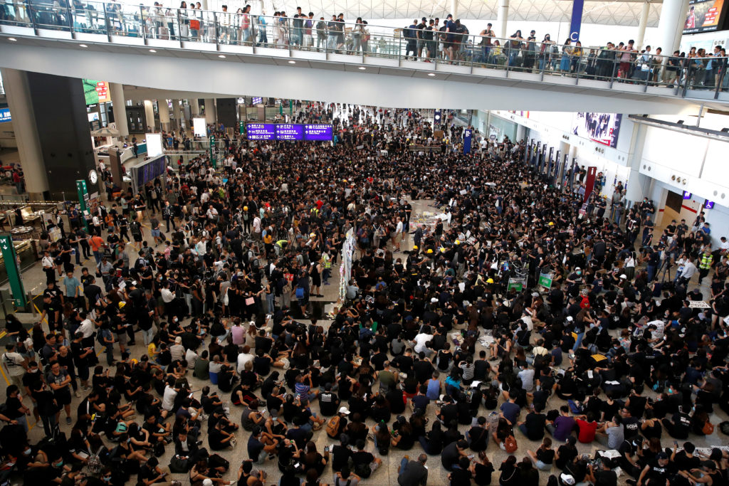 Hong Kong protesters crowd one of the world's busiest airports