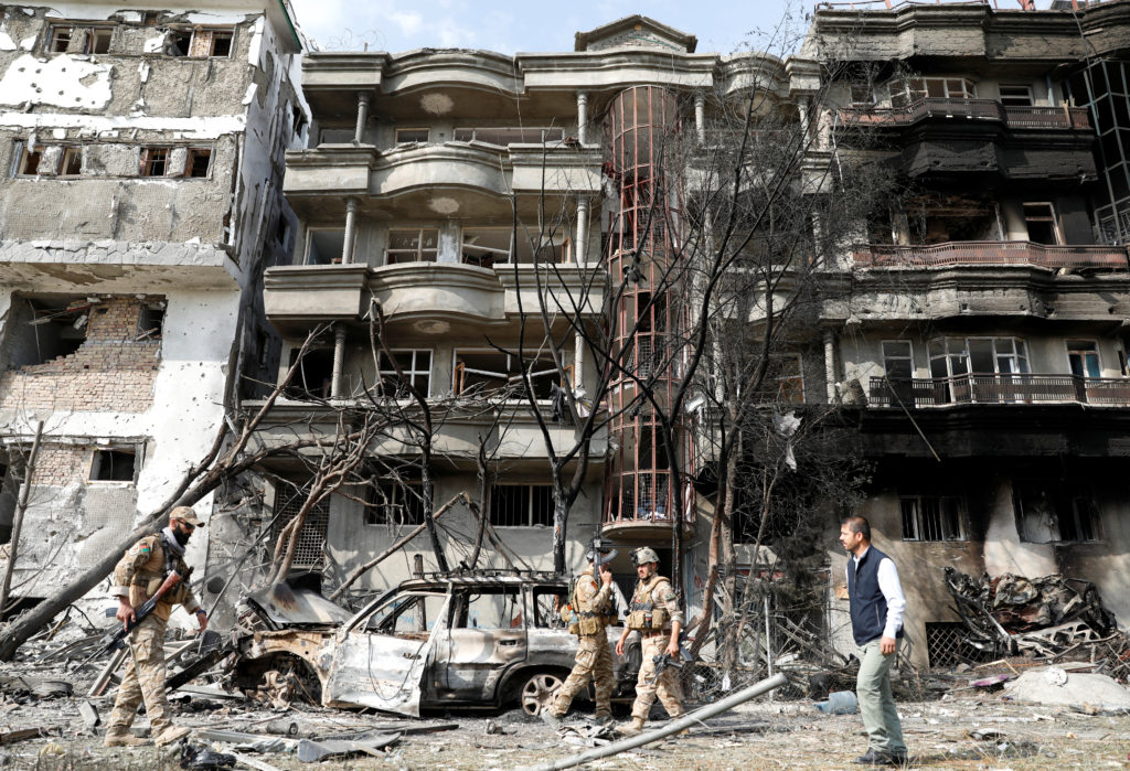 Afghan security forces inspect the site of Sunday's attack in Kabul, Afghanistan July 29, 2019. Photo by Mohammad Ismail/R...
