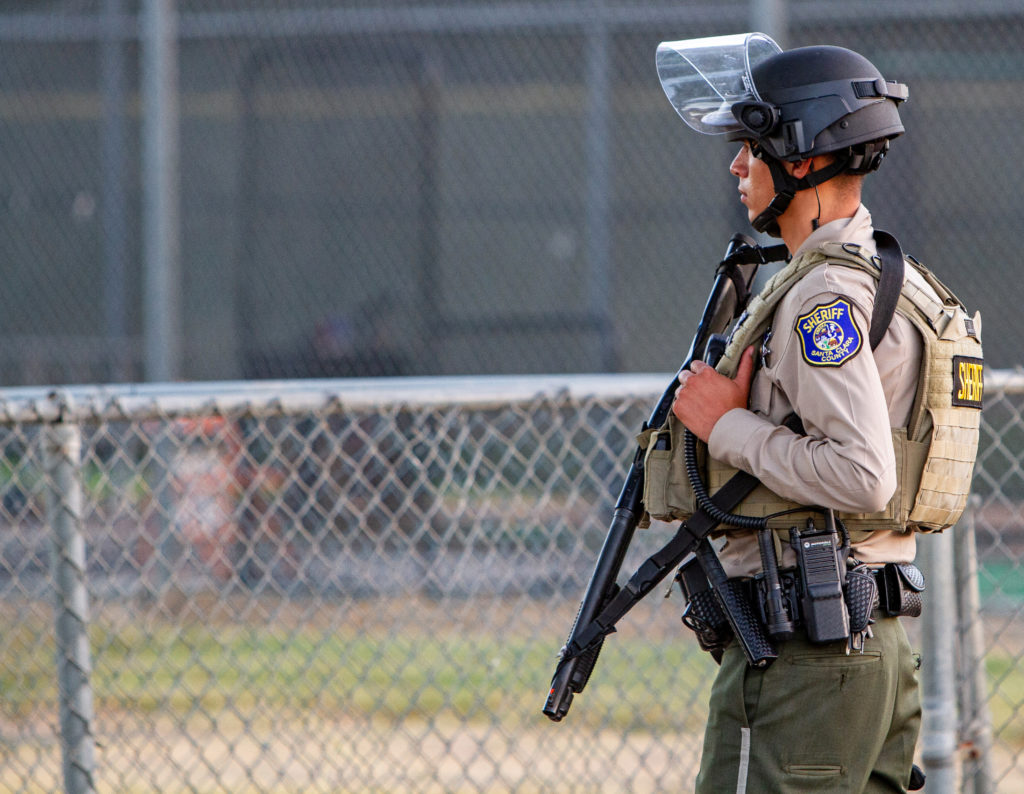 A police officer stands watch at the scene of a mass shooting durin…