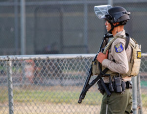 A police officer stands watch at the scene of a mass shooting during the Gilroy Garlic Festival in Gilroy, California, on July 28, 2019. Photo by Chris Smead/Reuters