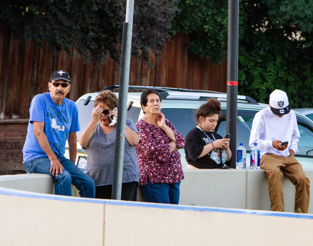 People look on from near the scene of a mass shooting during the Gilroy Garlic Festival in Gilroy, California, July 28, 2019. Photo by Chris Smead/Reuters