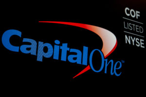 FILE PHOTO: The logo and ticker for Capital One are displayed on a screen on the floor of the New York Stock Exchange (NYSE) in New York, U.S., May 21, 2018. Photo by Brendan McDermid/Reuters