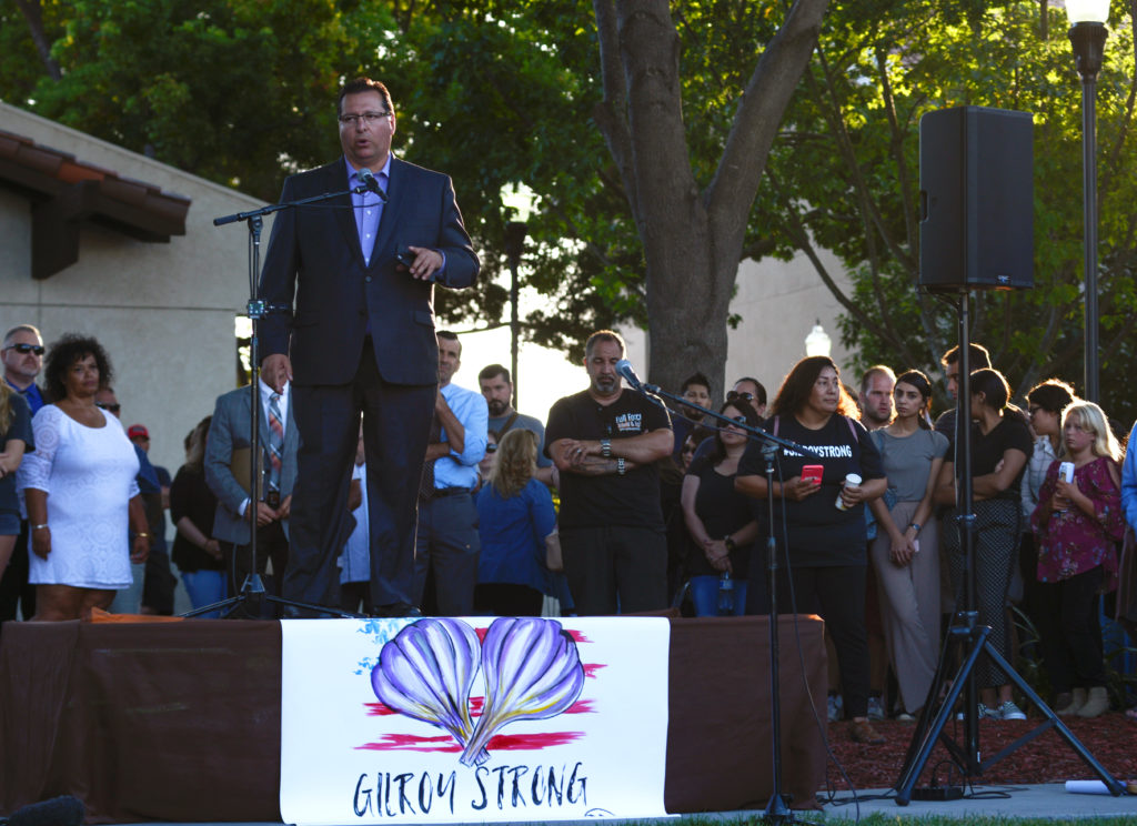 Mayor Ronald Velasco speaks at a vigil outside of Gilroy City Hall honoring those that died and were injured during a mass shooting at the Gilroy Garlic Festival  a day earlier, in Gilroy, California, July 29, 2019. Photo by Kate Munsch/Reuters