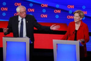 Senator Bernie Sanders and U.S. Senator Elizabeth Warren speak on the first night of the second 2020 Democratic U.S. presidential debate in Detroit, Michigan, U.S., July 30, 2019. Photo by Lucas Jackson/Reuters