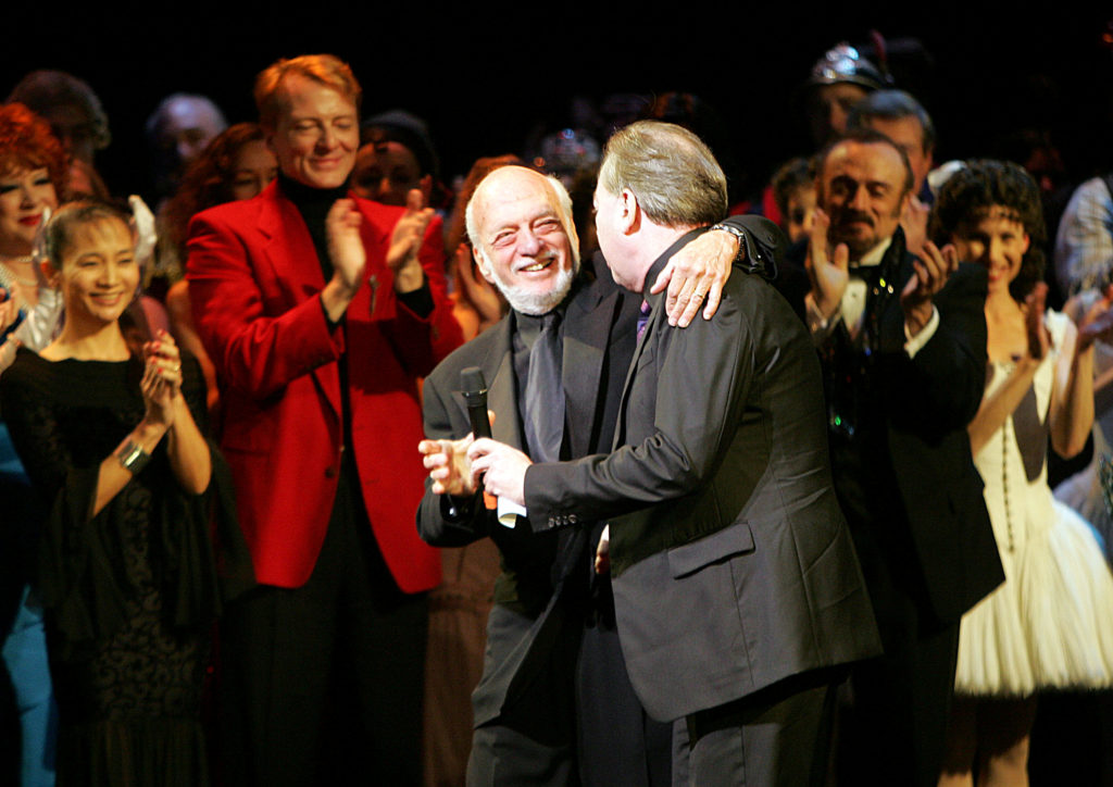 "Director Harold Prince (L) and composer Andrew Lloyd Webber greet one another during the curtain call of ""The Phantom of the Opera"" in New York City in 2006. Photo by Seth Wenig/Reuters"