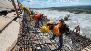 Workers repair the damaged Oroville Dam spillway in Northern California in March 2019. Photo by California Department of Water Resources