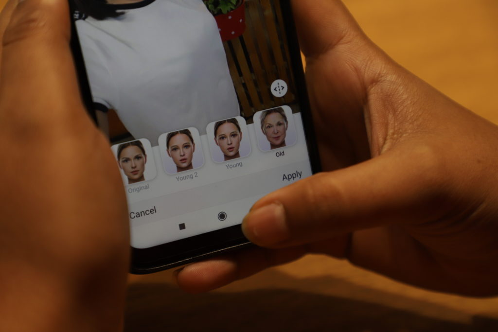 This illustration shows a user as she tries to edit her photo on FaceApp Photo by Nasir Kachroo/NurPhoto via Getty Images