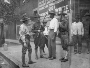 National Guardsmen, called in by Mayor 'Big Bill' Thompson after three days of rioting, question an African American man in Chicago, 1919. The National Guard was able to restore order to the riot-torn city. (Photo by Jun Fujita/Chicago History Museum/Getty Images)