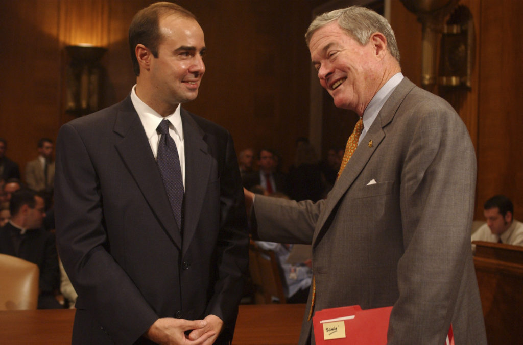 At left, Eugene Scalia, then-nominee for Solicitor of Labor, gets encouragement from then-Sen. Kit Bond, R-Mo., before Scalia's conformation hearing in 2001. (Photo By Tom Williams/Roll Call/Getty Images)