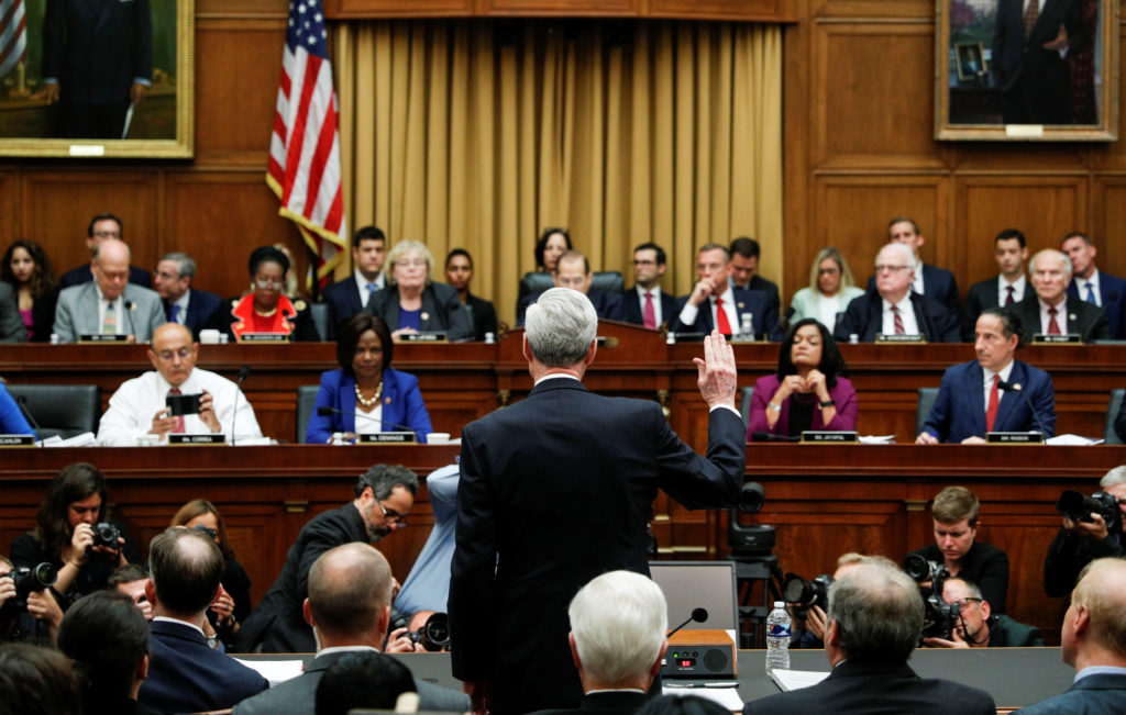 "Former Special Counsel Robert Mueller is sworn in to testify before a House Judiciary Committee hearing on the Office of Special Counsel's investigation into Russian Interference in the 2016 Presidential Election"" on Capitol Hill in Washington, U.S., July 24, 2019. REUTERS/Tom Brenner - RC1546167BC0"