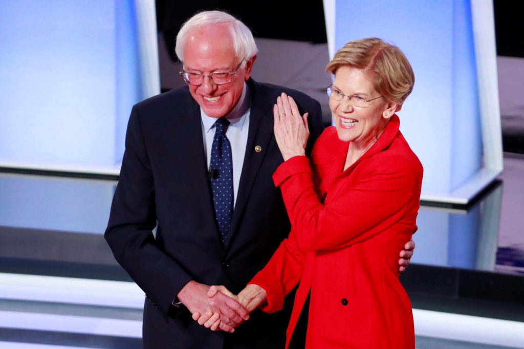 U.S. Senator Bernie Sanders and U.S. Senator Elizabeth Warren shake hands before the start of the first night of the second 2020 Democratic U.S. presidential debate in Detroit, Michigan, U.S., July 30, 2019. REUTERS/Lucas Jackson     TPX IMAGES OF THE DAY - HP1EF7V00K8IB