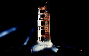 Saturn V rocket on launch pad at night. Photo by NASA