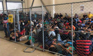 Migrants are crowded into a fenced in area at a Border Patrol facility in McAllen, Texas. Photo courtesy: Department of Homeland Security's Office of the Inspector General