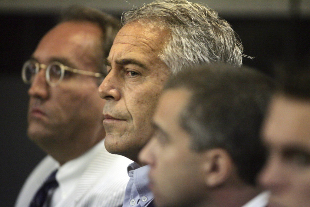 U.S. financier Jeffrey Epstein (center) appears in court where he pleaded guilty to two prostitution charges in West Palm Beach, Florida, on July 30, 2008. Photo by Uma Sanghvi/Palm Beach Post via Reuters