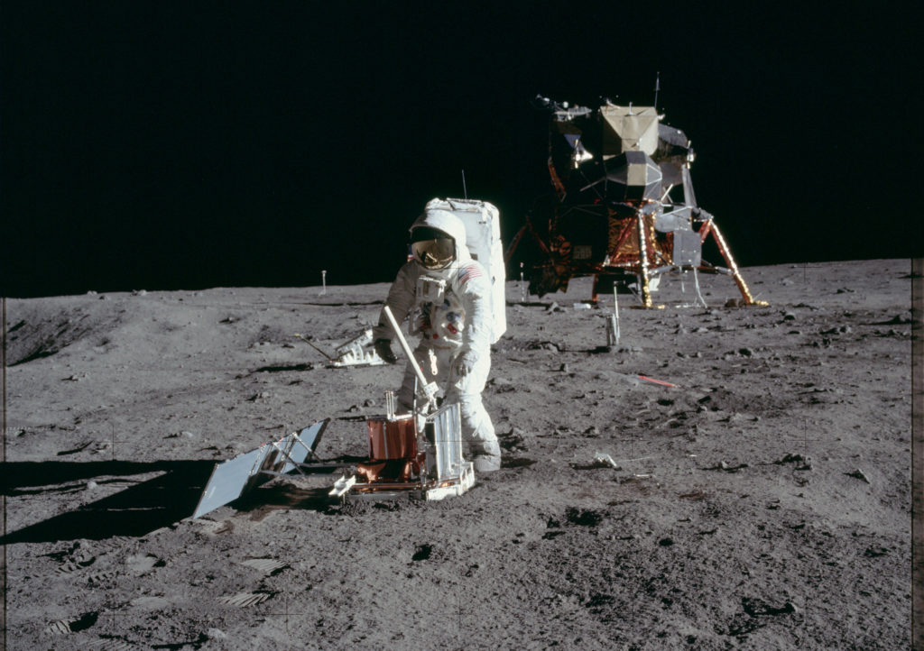 "Buzz Aldrin sets up a seismology experiment during the Apollo 11 mission to detect lunar ""moonquakes."" Photo by NASA"