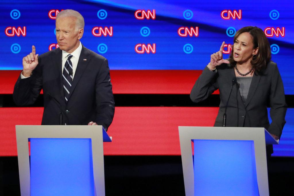 Former Vice President Joe Biden and U.S. Senator Kamala Harris gesture on the second night of the second 2020 Democratic U...