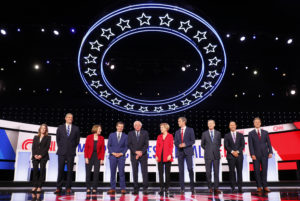 Democratic 2020 U.S. presidential candidates (L-R) author Marianne Williamson, U.S., Rep. Tim Ryan, U.S. Senator Amy Klobuchar, South Bend Mayor Pete Buttigieg, U.S. Senator Bernie Sanders, U.S. Senator Elizabeth Warren, former U.S. Rep. Beto O'Rourke, former Colorado Governor John Hickenlooper, former U.S. Rep. John Delaney, Montana Governor Steve Bullock pose together on the first night of the second 2020 Democratic U.S. presidential debate in Detroit, Michigan, July 30, 2019. Photo by Rebecca Cook/Reuters