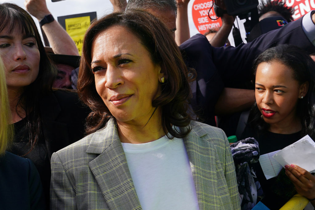 Sen. Kamala Harris stand outside a dentition facility for incarcerated youths near Miami in Homestead, Florida, on June 28...