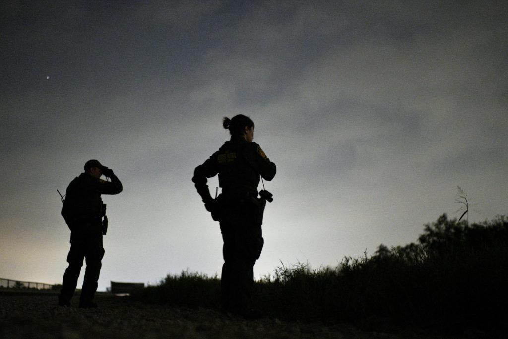 U.S. Border Patrol agents search for undocumented migrants after they illegally crossed the Rio Grande near Palmview, Texas, U.S., April 6, 2019. Photo by REUTERS/Loren Elliott