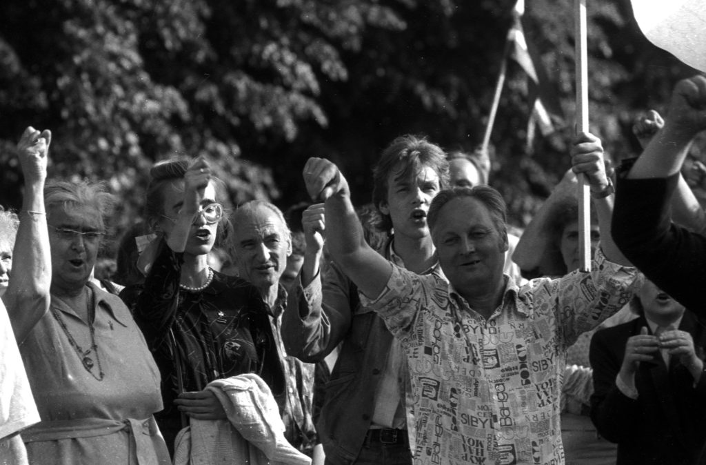 People hold hands as they participate in a human chain during the Baltic Way near Riga August 23, 1989.  More than two million people in the Baltic countries of Estonia, Latvia and Lithuania joined hands in one of the biggest mass protests seen against the former Soviet Union and demanded the restoration of independence. Photo by Ints Kalnins/Files via Reuters