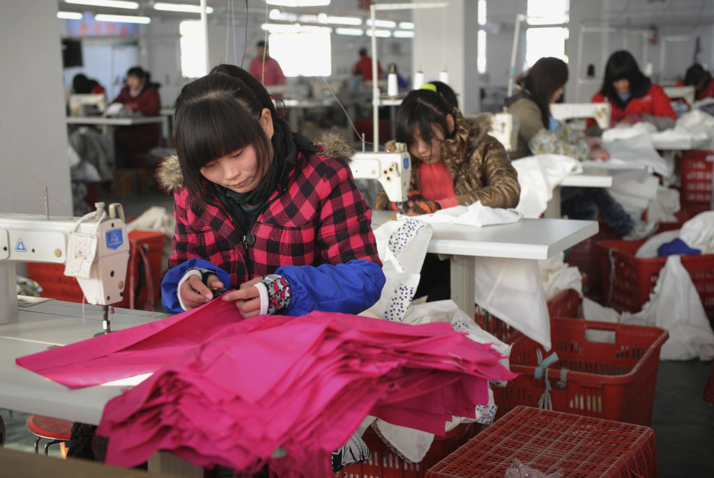 Employees work at a garment factory of Hefei Shichao Clothing Co. L…