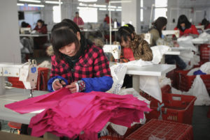 Employees work at a garment factory of Hefei Shichao Clothing Co. Ltd in Hefei, Anhui province January 16, 2011. The Trump administration is delaying some tariffs on Chinese clothing. Photo by Reuters