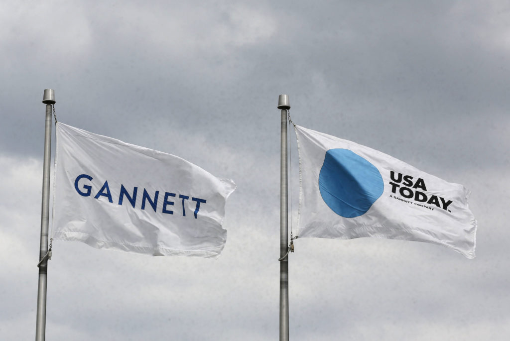The corporate flags for the Gannett Co and its flagship newspaper, USA Today, fly outside their corporate headquarters in McLean, Virginia, in 2013. Photo by Larry Downing/Reuters
