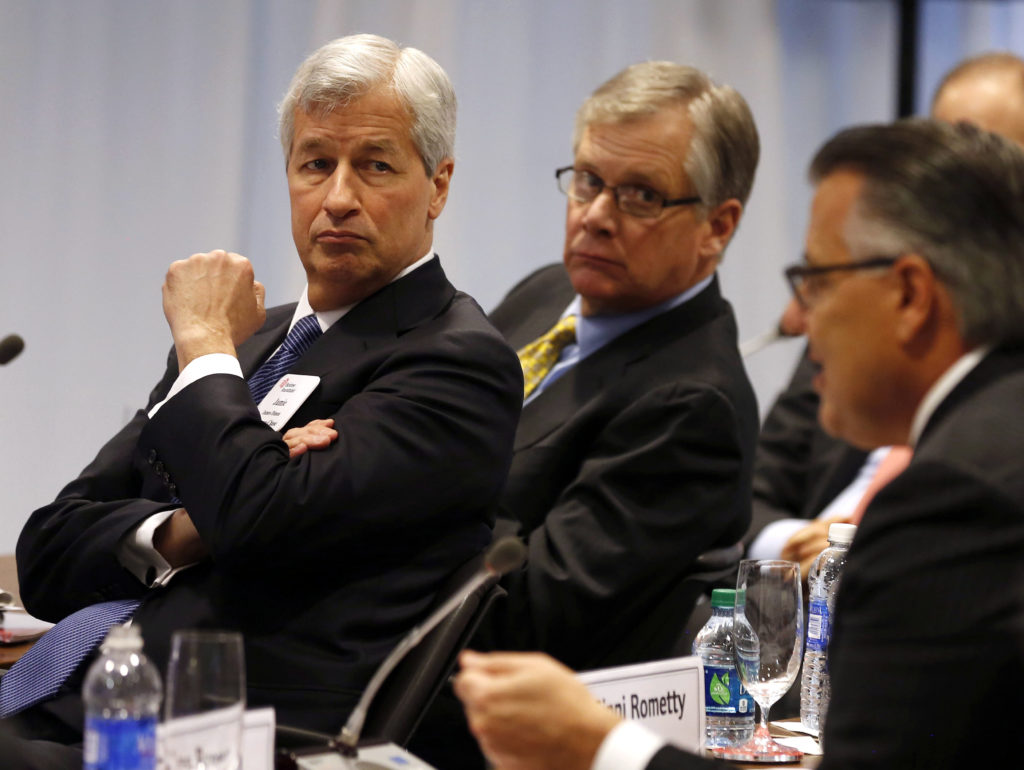 FILE PHOTO: Jamie Dimon, Chairman, President and CEO of JPMorgan Chase listens to a question for U.S. President Barack Obama at the quarterly meeting of the Business Roundtable in Washington, December 3, 2014. Photo by Larry Downing/Reuters