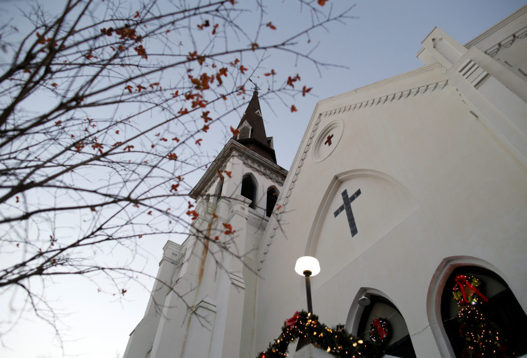 Christmas decorations and a small tree frame the Mother Emanuel AME…