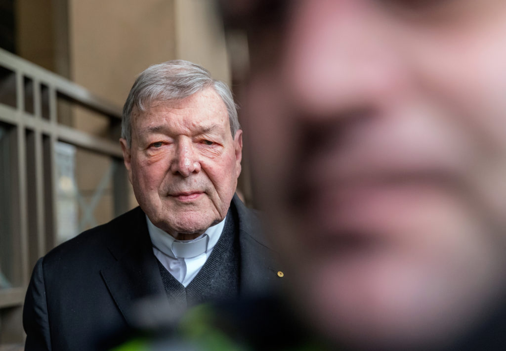 Vatican Treasurer Cardinal George Pell is surrounded by Australian police as he leaves the Melbourne Magistrates Court in Australia, October 6, 2017. Photo by Mark Dadswell/Reuters
