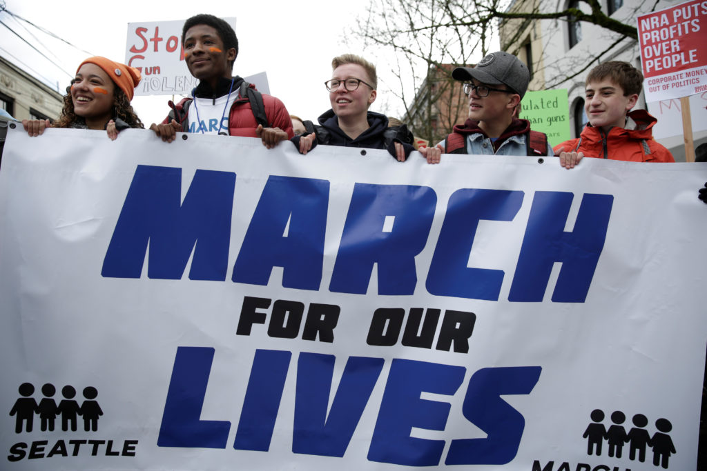 "High school students carry a banner during a ""March for Our Lives"" demonstration demanding gun control in Seattle, Washington, D.C. Photo by Jason Redmond/Reuters"