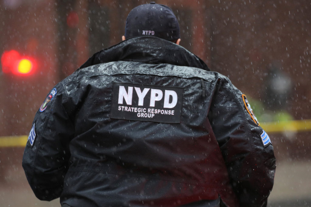 New York City Police Department (NYPD) officer arrives at 787 7th Avenue in midtown Manhattan where a helicopter was repor...