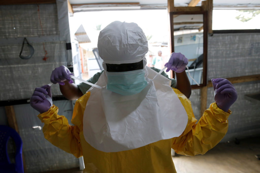 A health worker puts on Ebola protection gear before entering the Biosecure Emergency Care Unit (CUBE) at the ALIMA (The Alliance for International Medical Action) Ebola treatment centre in Beni, in the Democratic Republic of Congo. Photo by Baz Ratner/Reuters