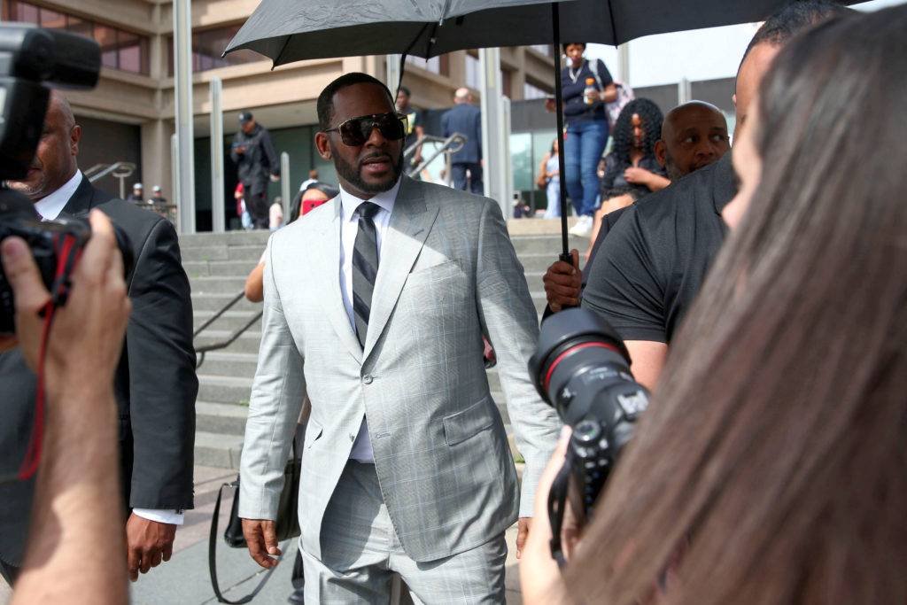 FILE PHOTO: R. Kelly leaves the Criminal Court Building after pleading not guilty during a hearing on eleven new counts of...