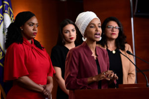 U.S. Rep. Ilhan Omar speaks alongside Reps. Rashida Tlaib (right), Alexandria Ocasio-Cortez (center) and Ayanna Pressley (left) at a news conference held after Democrats in the U.S. Congress moved to formally condemn President Donald Trump's attacks on the four minority congresswomen on Capitol Hill in Washington, on July 15, 2019. Photo by Erin Scott/Reuters