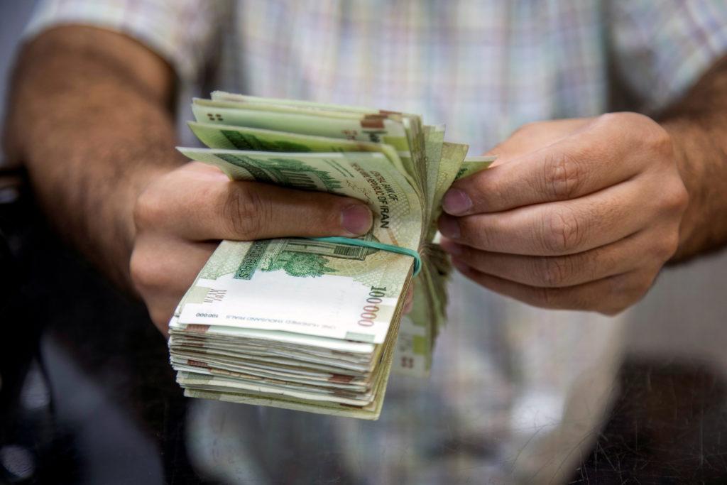 A salesman counts money in Tajrish Bazaar, Tehran, Iran August 1, 2019. Photo by Nazanin Tabatabaee/West Asia News Agency via REuters