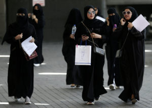 FILE PHOTO: Saudi students walk at the exhibition to guide job seekers at Glowork Women's Career Fair in Riyadh, Saudi Arabia October 2, 2018. Photo by Faisal Al Nasser/Reuters