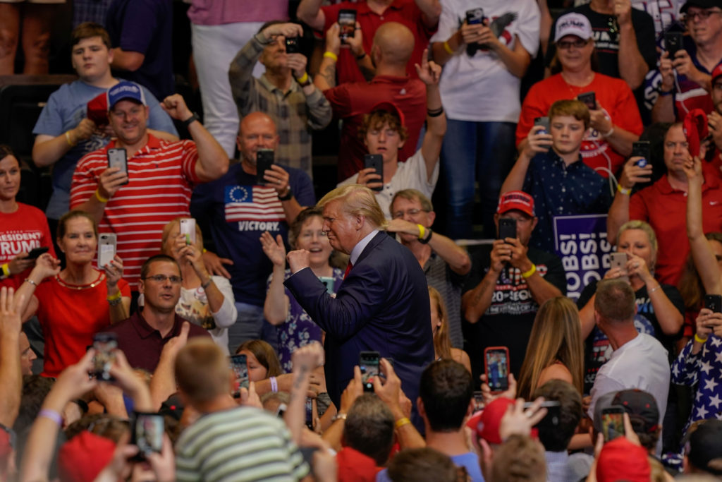 President Donald Trump acknowledges supporters as he departs a campaign rally in Cincinnati, Ohio. on August 1, 2019.   Photo by Bryan Woolston/Reuters