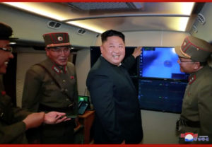 North Korean leader Kim Jong Un smiles with military officials in front of a screen believed to show projectile launch in an unidentified location, North Korea, in this still image taken from video provided by KCNA August 3, 2019. KCNA via REUTERS ATTENTION EDITORS - THIS IMAGE WAS PROVIDED BY A THIRD PARTY. REUTERS IS UNABLE TO INDEPENDENTLY VERIFY THIS IMAGE. NO THIRD PARTY SALES. SOUTH KOREA OUT. NO COMMERCIAL OR EDITORIAL SALES IN SOUTH KOREA.