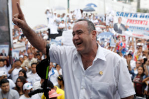 """Presidential candidate Alejandro Giammattei of """"Vamos"""" political party holds his closing campaign rally ahead of the second round run-off vote in Guatemala City, Guatemala on August 4, 2019. Photo by Luis Echeverria/Reuters"""