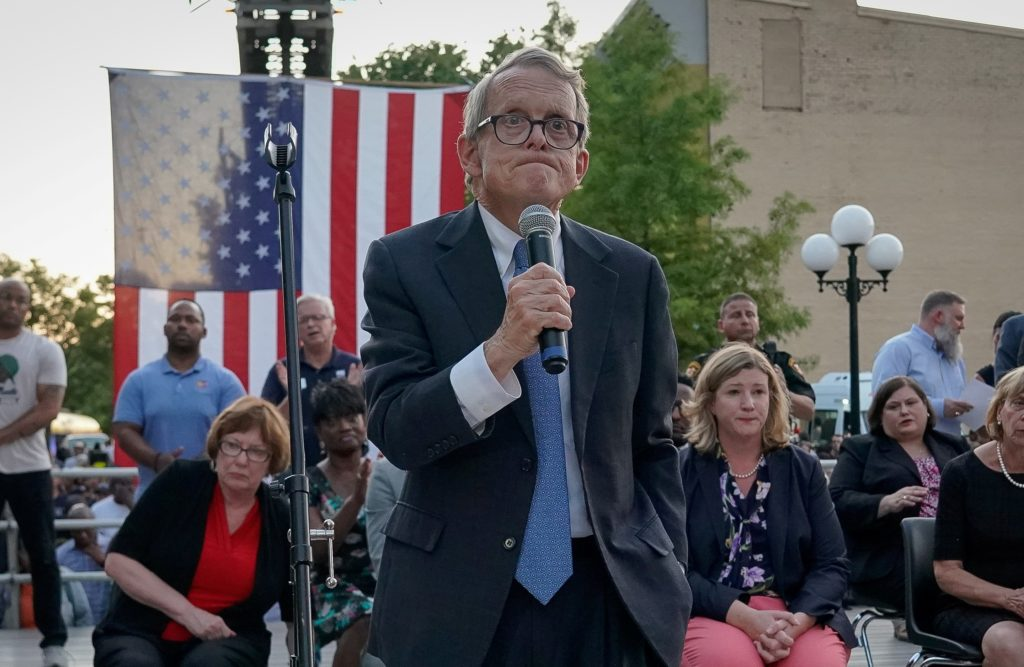 "Ohio Gov. Mike DeWine reacts as vigil attendees shout ""Do Something"" while he was speaking at a vigil at the scene after a mass shooting in Dayton, Ohio, on Aug. 4, 2019. Photo by REUTERS/Bryan Woolston"