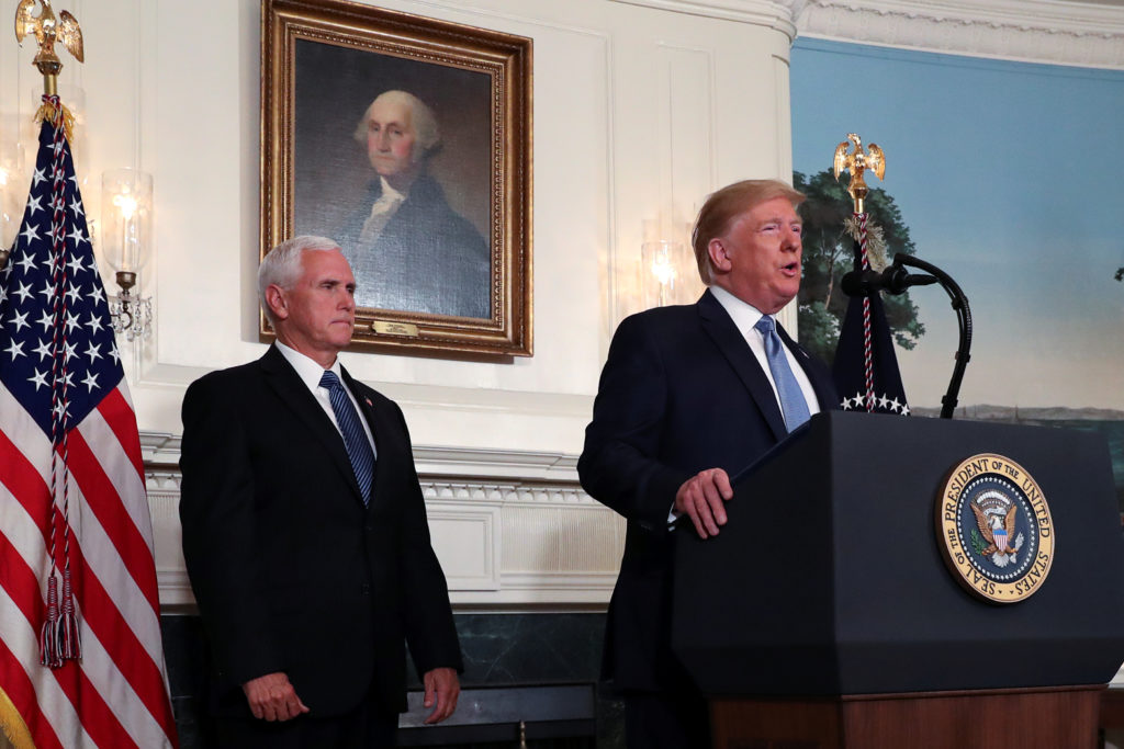 U.S. President Donald Trump speaks about the shootings in El Paso and Dayton as Vice President Mike Pence looks on in the Diplomatic Room of the White House in Washington, U.S., August 5, 2019. REUTERS/Leah Millis
