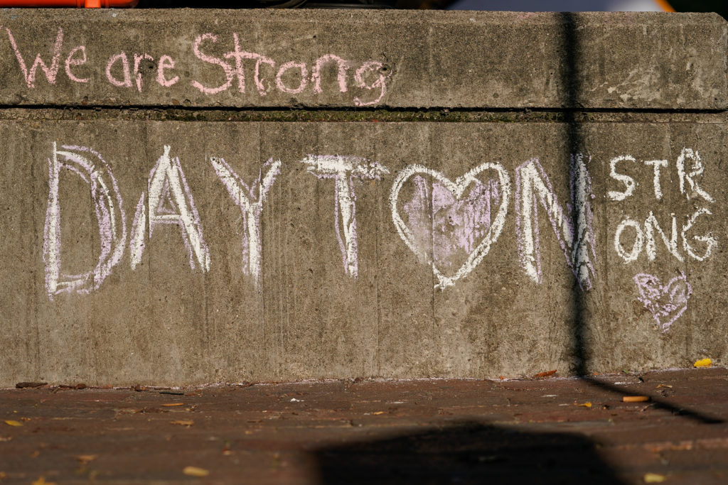 Chalk writing lines the street near the scene of Sunday morning's mass shooting in Dayton, Ohio. Photo by Bryan Woolston/Reuters