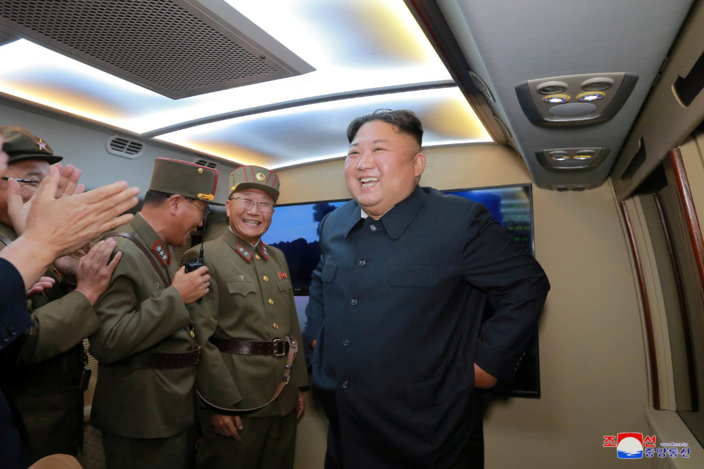 North Korean leader Kim Jong Un smiles as he guides missile testing at an unidentified location in North Korea, in this undated image provided by KCNA on August 7, 2019.