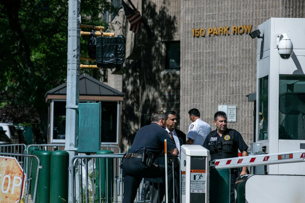 Police officers walk outside Metropolitan Correctional Center jail …