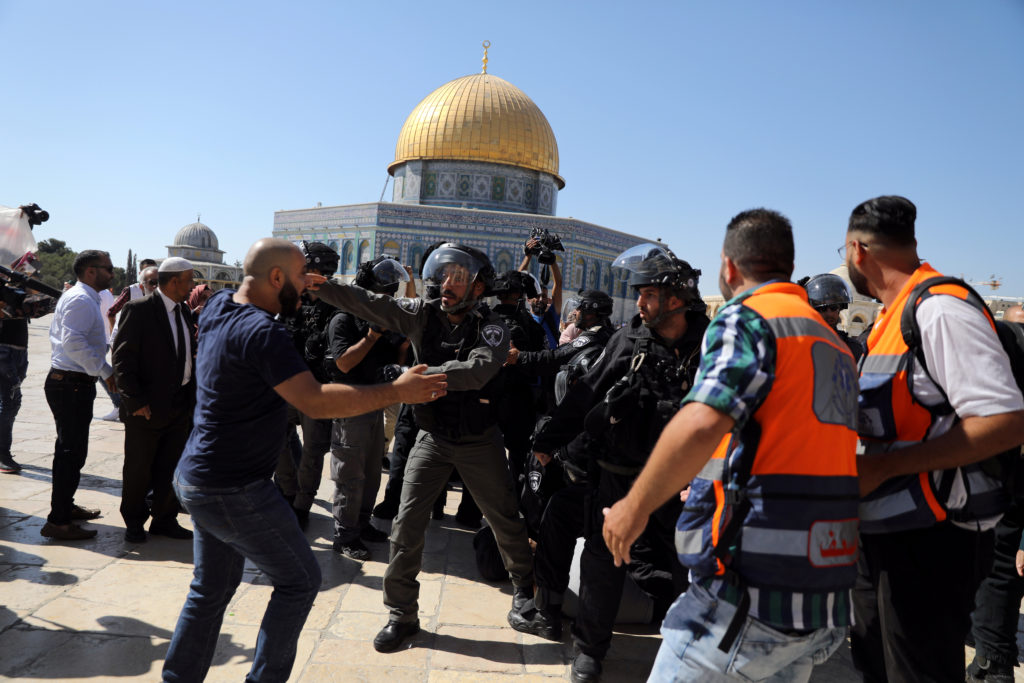 The Dome of the Rock is seen in the background as Israeli police clash with Palestinian worshippers on the compound known to Muslims as Noble Sanctuary and to Jews as Temple Mount as Muslims mark Eid al-Adha, in Jerusalem's Old City on August 11, 2019. Photo by Ammar Awad/Reuters