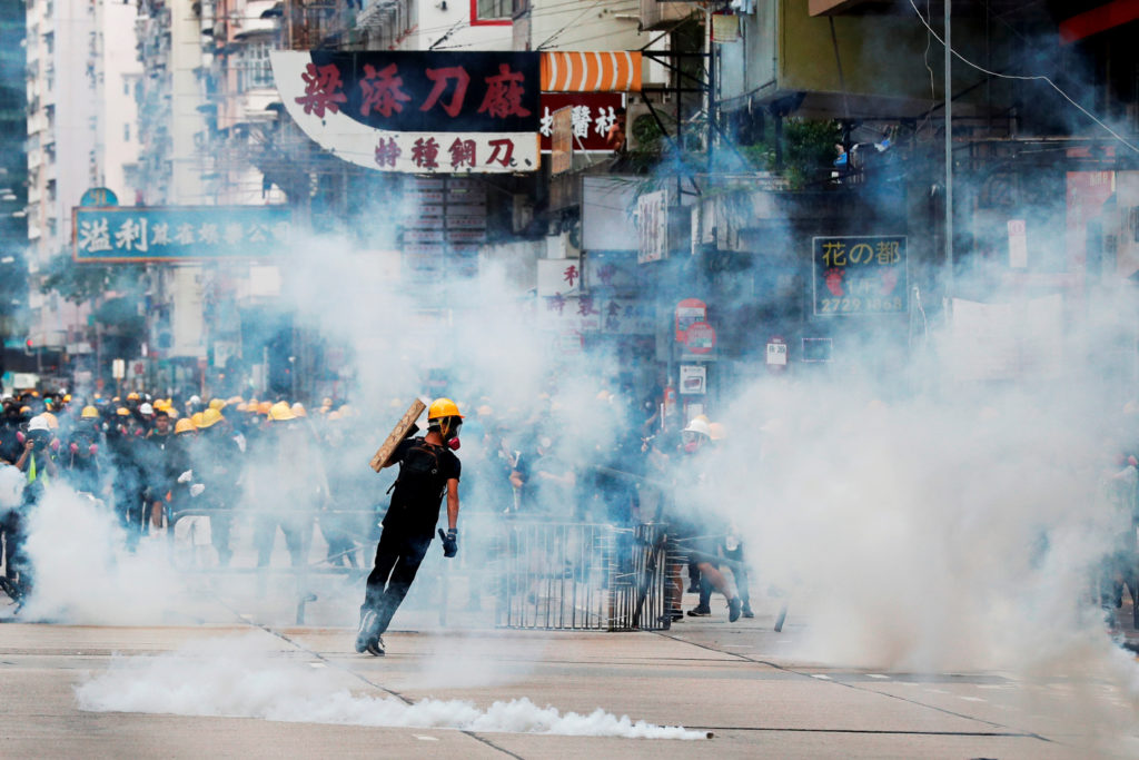 Anti-extradition bill protesters react from tear gas as riot police try to disperse them during a protest at Sham Shui Po in Hong Kong, China on August 11, 2019. Photo by Tyrone Siu/Reuters