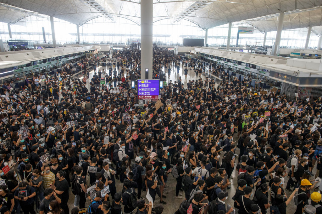 Anti-extradition bill protesters rally at the departure hall of Hong Kong airport in Hong Kong, China on August 12, 2019. Photo by Thomas Peter/Reuters